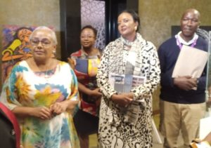 First Lady Margaret Kenyatta, CS Culture A. Mohammed & Christine Ng'ang'a with Kisii artist Robin Mbera at Windsor Hotel for Art & Finance Conference